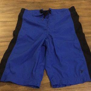 Boys blue Old Navy swim trunks. Medium